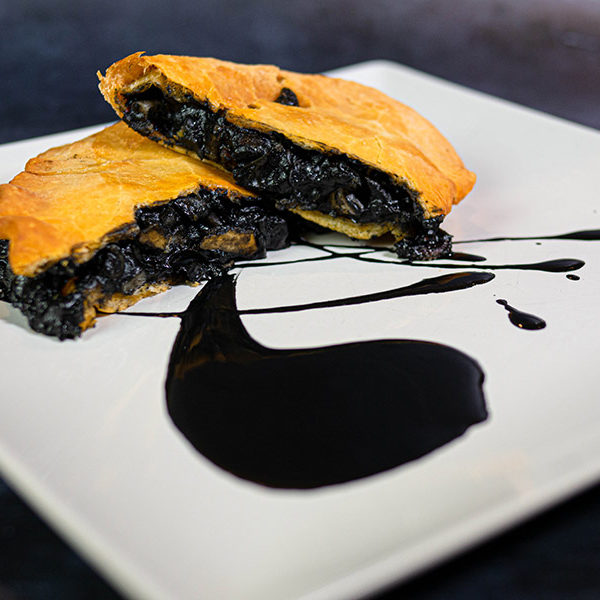 Empanada Couzapín de chipirones en su tinta | Restaurante asturiano Couzapín